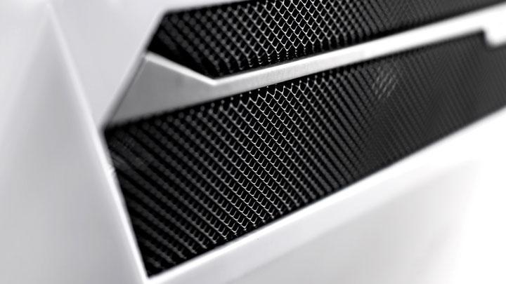 защитная радиаторная решетка в виде сетки на конвекторе какая лучше